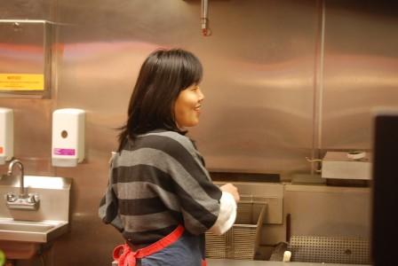 Sun Joo Choi at work at a Korean fast food station in Niles