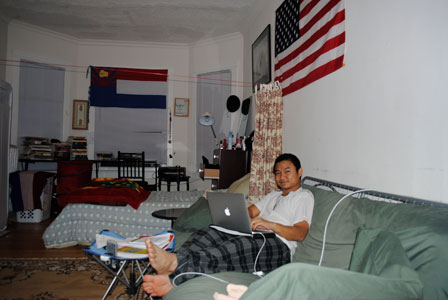 Poe Clee sits in his apartment in Rogers Park
